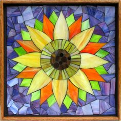 """Student Work - Framed Stained Glass Mosaic Sunflower 12"""" x 12"""" created by Rachael in a Stained Glass Mosaic Flower Workshop with Artist Kasia Polkowska - Next Upcoming Class in Boulder, Colorado is August 23-24 and September 13-14, 2014 Sign up on: www.kasiamosaics.com"""