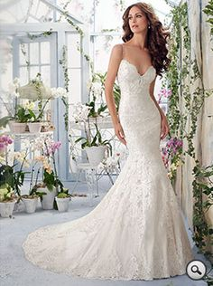 Mori Lee (Blu Collection) 5415 // Off-the-shoulder, fit-and-flare, all over Alençon lace bridal gown with a Sweetheart neckline. Scalloped edge hem and edging that contours the net gown with appliqués and crystal beading. Zip-up back with a Court length train.