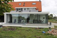 Floor to ceiling sliding glass doors as a modern patio door option