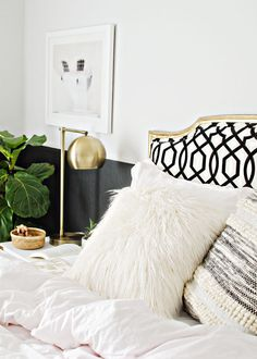 black, white & gold bedroom design, white furry pillow, target textured pillow, gold lamp