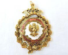 Curiosa medalha/condecoração de origem espanhola, com o..
