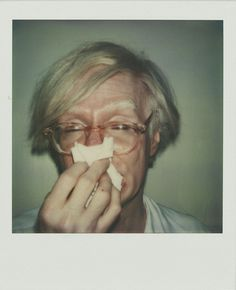 Andy Sneezing (1978), a SX70 selfportrait by Andy Warhol