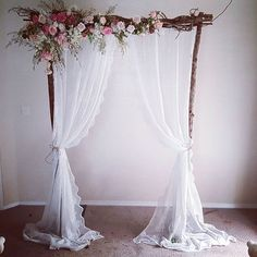 Vintage wedding arbour. With lace curyains and fresh flowers. Ceremony…