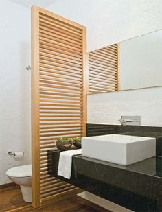 """This is a nice way to """"hide"""" the commode. both basement & main (maybe an old door?)"""