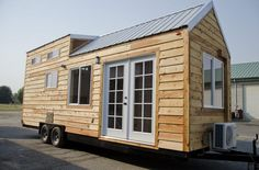 I'm excited to show you this spacious tiny house on wheels by Tiny Idahomes. Tiny Idahomes LLC is a tiny house builder in Nampa, Idaho. They build custom tiny homes for their clients and so far hav...