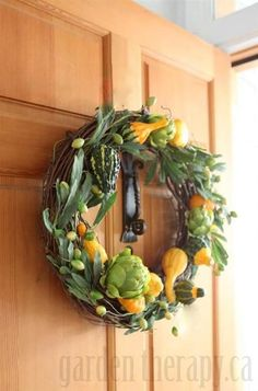 Fall Harvest Wreath Made With Ornamental Gourds.