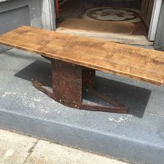 Oak table with old car springs and upholstery machine parts.