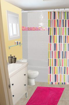 Colourful with yellow walls (shower curtain and mat from IKEA)