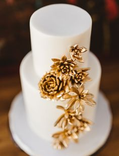 Gold succulent wedding cake | by Sweet and Saucy Shop