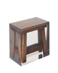 Made Goods from Mecox Gardens - traditional Japanese stool encased in acrylic. Love the juxtaposition!