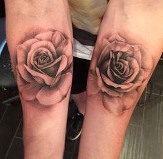 Rose tattoo realistic style black n white