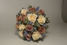 Antique Amnesia roses, creamy Vendella roses, blue muscari and eucalyptus foliage