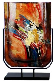 """In our Red Reflections series, this 19 inch vase has an array of colors of fused art glass. Stand is included. At 19""""tall this piece is very impressive and will command attention anywhere in your room"""