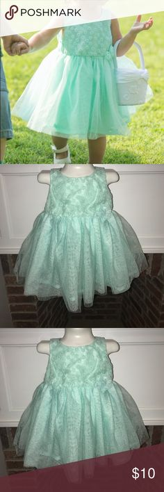 """Mint green tulle formal Easter flower girl dress Beautiful mint green flower girl dress! My daughter wore this for a wedding rehearsal, and it was so darling! It is a pretty """"dark"""" mint or teal green and has fluffy tulle skirt. Size is 12 Months, in good preowned condition with minimal signs of wear Dresses Formal"""