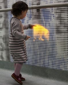 The Jason Bruges 'distraction wall' at Great Ormond Street Hospital/London: the wall come to life (animals appear) via 72 000 LEDs when sensors in the ceiling sense movement below - designed for making a journey to operating theatre more positive experience for children and their families.