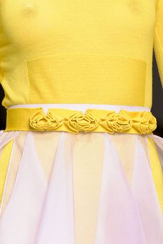 yellow ribbon belt with folded pleat into floral lookalike