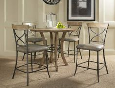 Charleston 5-piece Counter Height Round Wood Dining Set With X Back Stools by Hillsdale Furniture. $899.00. Finish Light Wood. Assembly Required Some assembly required. Color Beige. Style Rustic. Material Metal. Hillsdale's Charleston collection beautifully combines a rustic Desert Tan wood finish with a dark grey metal and offers a multitude of choices to create the perfect Counter height dining group for your home. Starting with the non-swivel stools, you have the choice of ...