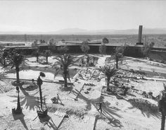 1945 vintage Las Vegas photo • Swimming pool construction at the Flamingo Hotel & Casino • Mt. Potosi is visible in the distance.