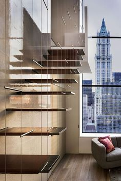 ♂ Modern interior design with interesting stairc and a tall window with great urban city view