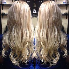 Heavy highlight with a dark blonde base. Blonde hair. Dark blonde hair. Wavy hair. Beach hair. Long hair.