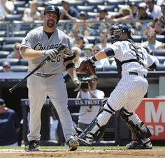 GAME 77: Saturday, June 30, 2012 - Chicago White Sox batter Kevin Youkilis, left, reacts after striking out as New York Yankees catcher Russell Martin returns the ball during the first inning of a baseball game at Yankee Stadium in New York.