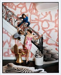 In the foyer of interior designer Kelly Wearstler's Beverly Hills home, it seems that her boys have painted the walls, when, in fact, that is Kelly Wearstler wallpaper, which she has paired with a geometric runner that is also of her own design.