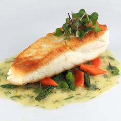 Tender halibut filets are sauteed and served with a luscious French lemon dill beurre blanc sauce.