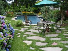 Salt water pool with english garden- not so much exactly this pool as how it is integrated into a traditional garden