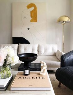 modern glam living room, modern neutral living room with abstract art and modern coffee table decor, modern coffee table styling in glam elegant living room decor accent luxury