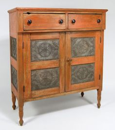 Virginia, Pie Safe, in old salmon paint, circa 1845, two drawers over double doors, the doors and side panels with inset pinwheel pierced tin, on turned legs, 51 H. x 43.5 W. x 19 D.