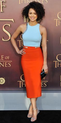 Nathalie Emmanuel premiered Season 5 of HBO's Game of Thrones in a bright Mugler skirt and powder blue tank, which she paired with Stuart Weitzman sandals and a metallic clutch. Orange Outfits, Orange Skirt Outfit, Blue Skirt Outfits, Pencil Skirt Outfits, Colourful Outfits, Orange Is The New Black, Orange Pencil Skirts, Nathalie Emmanuel, Star Fashion