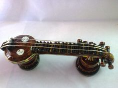 This indian musical insturment small veena made with waste xerox  papers cut into quilling  strips (quilling 3d art)