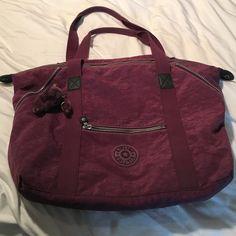 Dark purple overnight/weekend bag Kipling overnight bag in purple! Worn once, still has the cute little monkey key chain! Kipling Bags Travel Bags