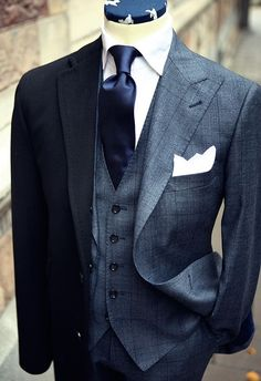 "Gray suit with a lighter grey vest and color co-ordinated tie make for a ""SHARP"" business or formal affair look!"