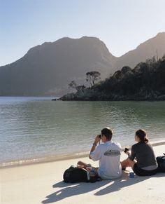 Volunteers relax at Wineglass Bay in Tasmania