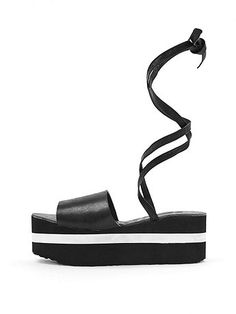 """2 3/4"""" (7 cm) platform sandal featuring soft ankle ties and a graphic white stripe. Made in the USA."""