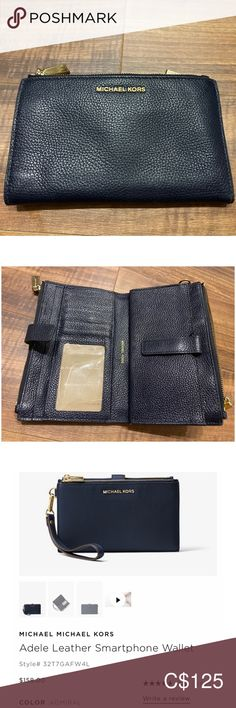 Michael Kors smartphone wallet in navy blue Navy blue wallet with pocket for your smart phone.
