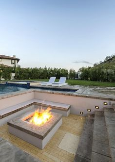 A fire pit rounds out the gorgeous backyard. Source: Ewing & Associates / Sotheby's