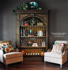 Our iron gated cabinet just got wider and taller. So wide you can remove the top shelf and use it as a TV cabinet. See this new furniture piece at accentsofsalado.com.