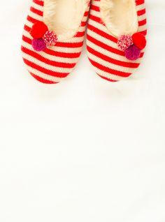 striped slippers with pom poms