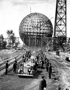 Franklin D. Roosevelt arrives with his entourage in front of the perisphere at the World's Fair in New York circa 1939.