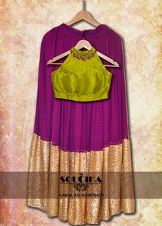 Purple lehenga with green raw silk hand embroidered blouse only from Soucika by Kamal Raj Manickath.