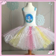 A beautiful, sparkly Olaf In Summer tutu dress. Frozen Tutu Dress. Beautiful & lovingly handmade.  All characters and colours available Price varies on size, starting from £25.  Please message us for more info.  Find us on Facebook www.facebook.com/DiddyDarlings1 or our website www.diddydarlings.co.uk