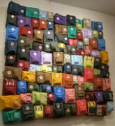 Great wall display of backpacks at Fjällräven in Nolita, New York. #retail #merchandising #wall #display #backpacks #fashion