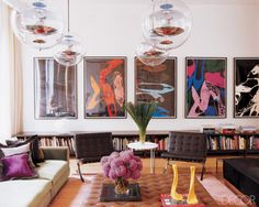 living room- low book shelves, globe pendants, linear art work display