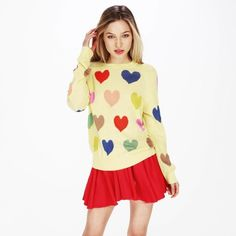 WILDFOX Mod Pop Hearts 70's Sweater Wildfox White Label Mod Pop Hearts 70's Sweater. It features colorful, hearts knit throughout this totally retro piece. Crewneck and a slightly fitted body contrasted by ribbed hems. Tightly knit from a super-soft, cotton blend.  -60% Cotton, 40% Acrylic. -Size Small. -In good condition, some pilling in sweater.  NO Trades. Please make all offers through offer button. Wildfox Sweaters