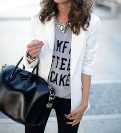 For an effortlessly chic ensemble, go for a graphic tee, statement necklace and crisp white blazer paired with black skinnies. Don't forget your carry-all handbag!