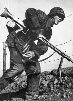 Machine Gunner of the 12. SS-Panzer-Division Hitlerjugend in action. http://www.vantiques.nl