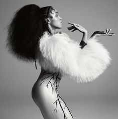 FKA twigs wears sheepskin jacket by Chanel, bodysuit by Oliver Theyskens archive, pearl earrings by Delfina Delettrez