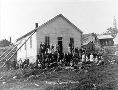 A group of school children stands in front of the schoolhouse in Caribou, a mining town in Boulder County, Colorado, near the end of the 19th century during the area's mining heyday. Date between 1935 and 1950? Denver Public Library Western History/Genealogy Dept.